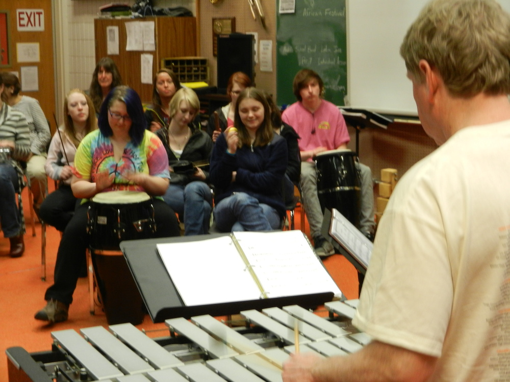 Photo of John Damberg teaching a group of students
